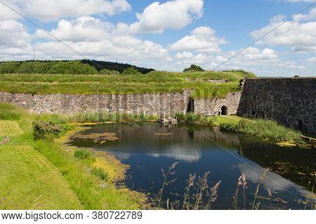 Bohusl N, Sweden - June 17 2019: The View Of Bohus Fortress Pond On June 17 2019 In Kung Lv, Sweden.