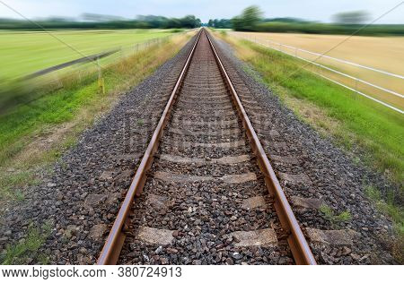 Diminishing Perspective View At A Railroad Track With A High Speed Motion Blur