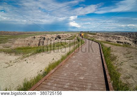 Scenic, South Dakota - June 21, 2020: Tourists Hike Along The Boardwalk To The Big Badlands Overlook