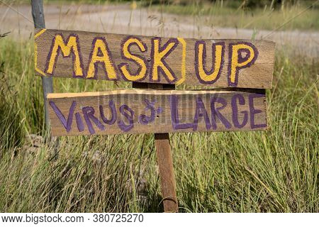 Mask Up Virus At Large Sign Along The Road, Reminding People To Wear A Mask During The Covid-19 Pand
