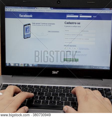 Alvador, Bahia / Brazil - January 5, 2014: Person Is Seen Using Laptop To Access The Social Network