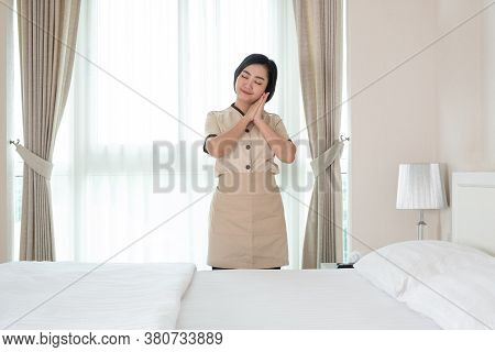 Young Asia Chambermaid In The Hotel Room
