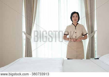 Young Asia Chambermaid In The Hotel Room Her Lool At Camera