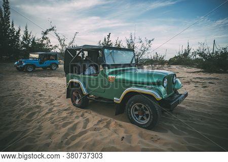 Restored Retro Jeep Willis During The American Vietnam War On The Sand In The Desert Of Vietnam. Des