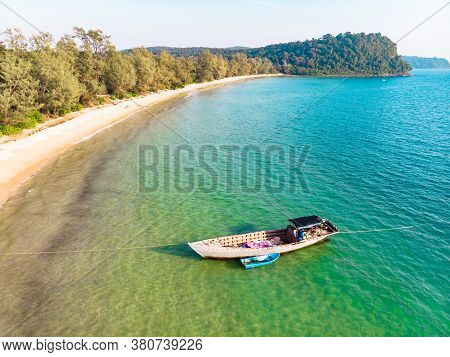 Fishing Boats Are Sailing In The Sea To Catch Fish. The Fishing Boat Is A Boat Made Up Of Wood And A