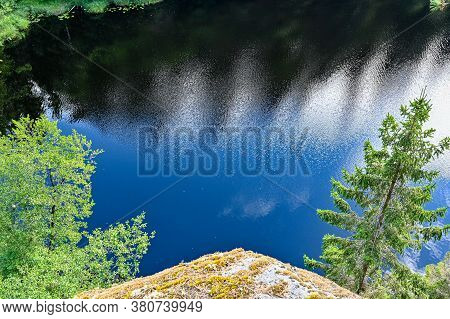 Overlooking A Little Lake From A Mountain In Sweden