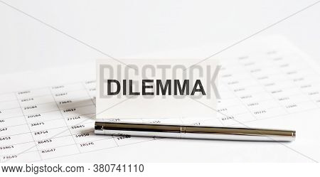 Text Dilemma On Stickers,pen On The Background Of Documents. Financial Bookkeeping, Accounting Conce