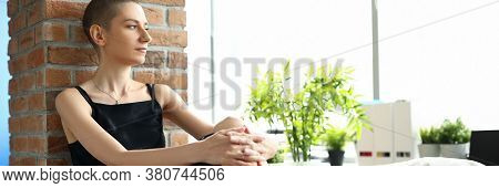 Portrait Of Sad Female Person Looking Away With Calmness And Seriousness. Thoughtful Woman Sitting O