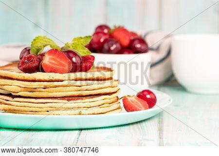 Pancake Breakfast. Homemade Pancakes With Fresh Berry And Honey, Light Background.