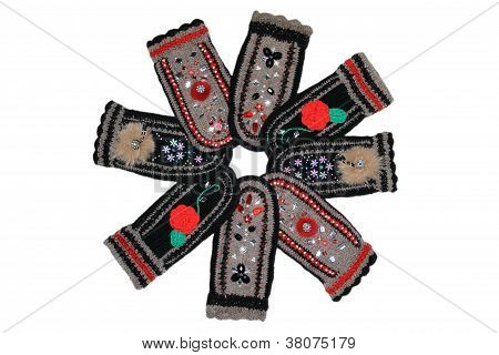 Picture of woollen mittens with patterns on a white background poster