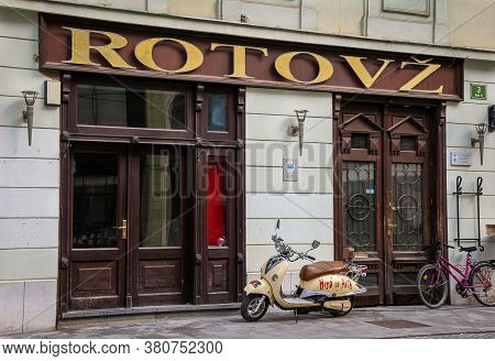 Ljubljana, Slovenia - July 16th 2018: Rotovz Or City Hall In Mestni Trg, With A Vespa Motorcycle Par