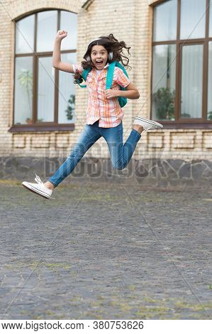 Share Happiness, Share Your School Activity. Energetic Child Jump Outdoors. Happiness Concept. Back