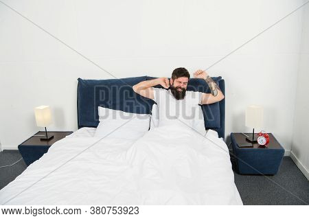 Man Stretching In Bed. Carefree Guy Enjoying Morning. Wake Up. Enjoying Carefree Morning. Lazy Man H