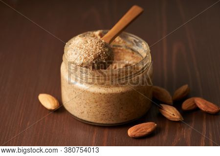 Almond Butter, Raw Food Paste Made From Grinding Almonds Into Nut Butter, Side View
