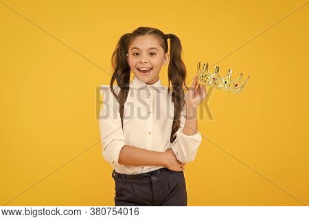 That Pride Of Hers. Happy Small Girl Holding Crown With Pride On Yellow Background. Adorable Little