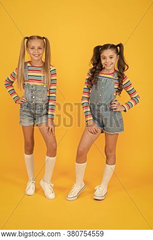 Hip And Stylish. Best Friends Forever. Small Sisters Have Fun. Little Girls Yellow Background. Haird