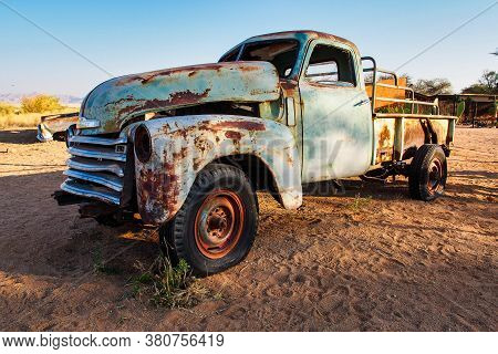 Solitaire, Namibia - Jul 12, 2019: Wrecked Cars Lie Abandoned In The Desert Surrounding Solitaire In