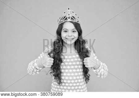 Promoting Your Content. Happy Child Give Thumbs Ups Blue Background. Princess Girl Wear Crown. Promo