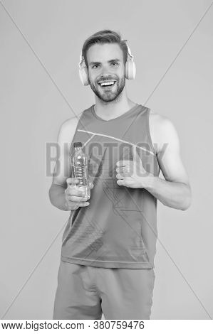 Drinking Water. Cheerful Athletic Guy Listening Music. Keep Body And Mind In Good Shape. Happy Sport