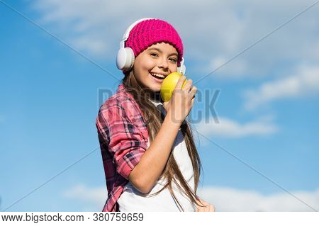 Apple A Day Keeps Cavities Away. Happy Girl Enjoy Eating Apple. Fruit Snack. Healthy Eating Habits.
