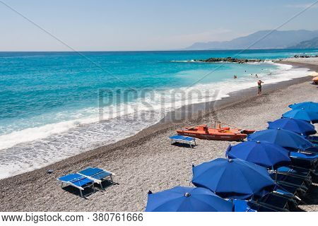 Bordighera, Liguria, Italy July 25 2015:  Scenic View Of The Beach And Mediterranean Sea In Bordighe