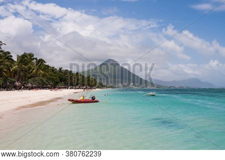 Flic En Flac, Mauritius Island, March 13 2017:  Scenic View Of The Sand Beach And Aqua Water At Flic