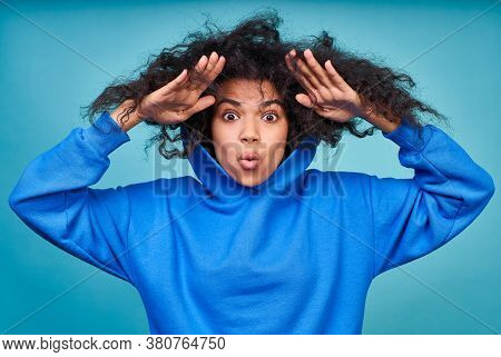 Close-up, Surprised, Shocked, Discouraged Young African American Woman, Wearing A Blue Hoodie, Holdi