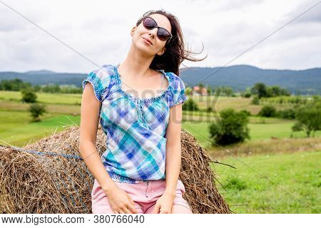 Beautiful Woman Smiling In Nature. Happy People Lifestyle. Woman In Fields In Nature. Nature Lifesty