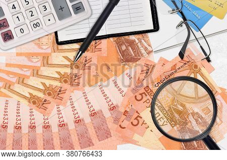 5 Belorussian Rubles Bills And Calculator With Glasses And Pen. Tax Payment Season Concept Or Invest