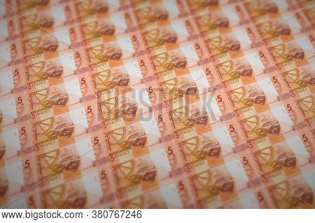 5 Belorussian Rubles Bills Printed In Illegal Money Production Conveyor. Collage Of Many Fake Bills.