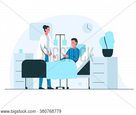 Female Doctor Talking To A Patient In A Hospital Ward. Friendly Doctor Cheking On A Patient During T