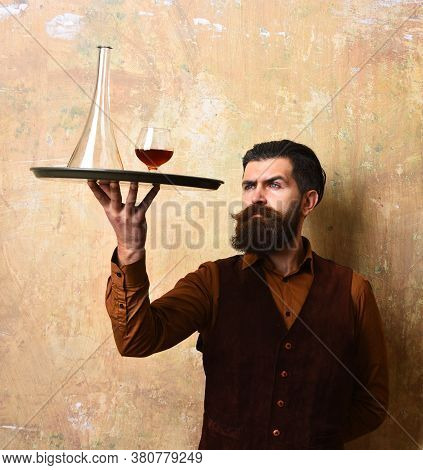 Barman With Curious Face Checks Scotch Or Brandy Color