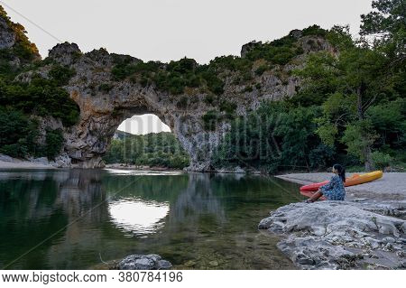Woman On The Beach By The River In The Ardeche France Pont D Arc, Ardeche France, View Of Narural Ar