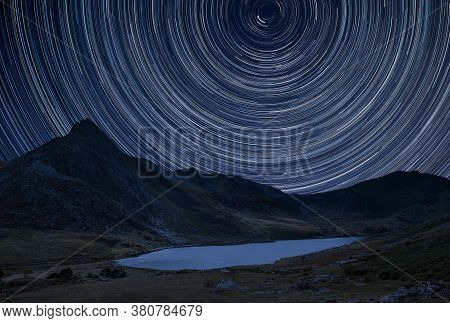 Stunning Vibrant Milky Way Composite Image Over Beautiful Landscape Image Of Stream Near Llyn Ogwen