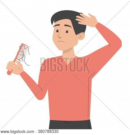 Man Holding Comb With Hair On It