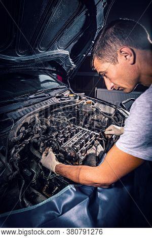 Services Car Engine Machine Concept, Mechanic In Uniform Repairing A Car Engine