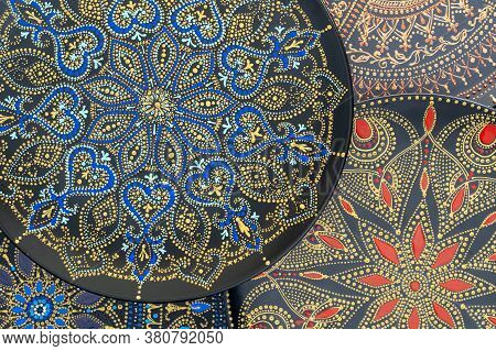 Decorative Ceramic Plate With Black, Blue, Red And Golden Colors, Painted Plate On Background, Close