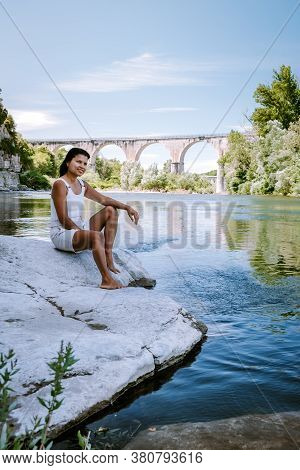 Woman On Vacation In Ardeche France, View Of The Village Of Vogue In Ardeche. France