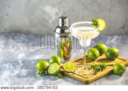 Margarita Cocktail With Lime And Ice On Minton Light Gray Concrete Table With Amazing Backlight, Cop