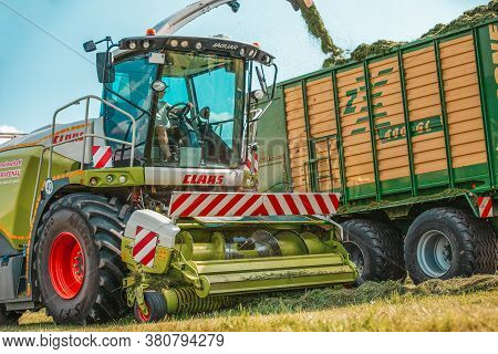 Bavaria / Germany - August 07,2020: Claas Jaguar 930 Harvester And A Fendt 926 With A Krone Zx400gl