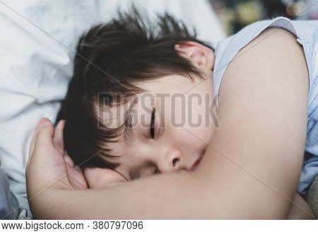 Cropped Shot Child Boy Sleep With His Eyes Half Open On His Bed, Close Up Young Kid Sleeping With Op