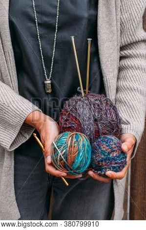 Woman Holds Multi-colored Bright Balls Of Woolen Yarn For Knitting. Knitting Yarn, Knitting Needles,