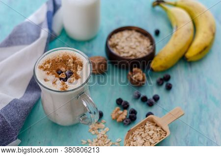 Oatmeal Porridge With Blueberries And Almonds. Healthy Breakfast Porridge Oats On A Wooden Table. To