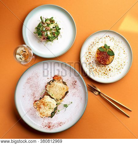 Florentine Eggs - Poached Eggs And A Delicious Avocado Salad, Dessert Cr Me Brulee In Orange Backgro