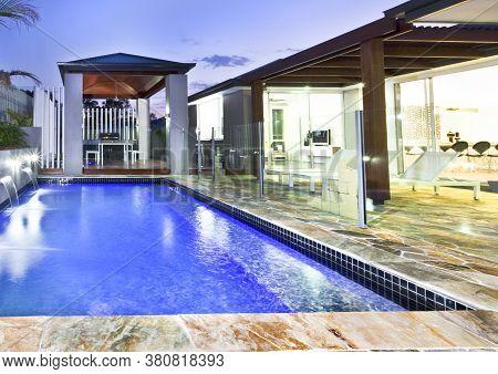 A Large Swimming Backyard Pool In Modern House