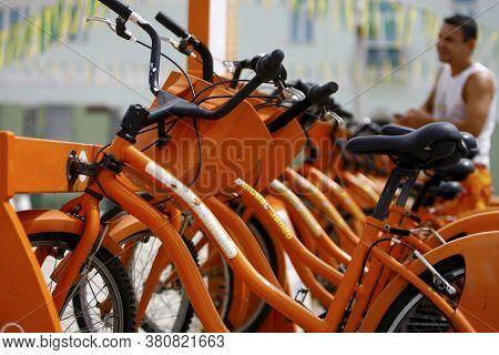 Salvador, Bahia / Brazil - August 22, 2014: Users Of The Salvador Vai De Bike Project Remove A Bicyc