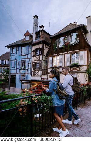 Couple On City Trip Colmar, Alsace, France. Petite Venice, Water Canal And Traditional Half Timbered