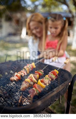 Barbecue, grilling.Family time together- barbecue grill with various kinds of juicy meat