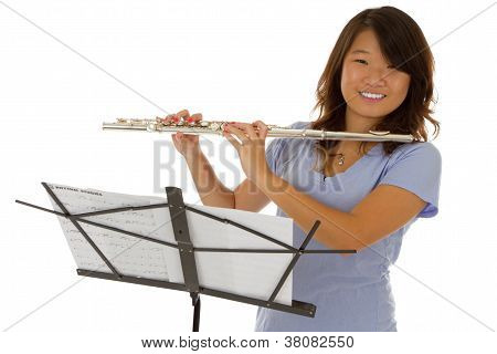 Young Pretty Asian Girl Playing A Silver Flute
