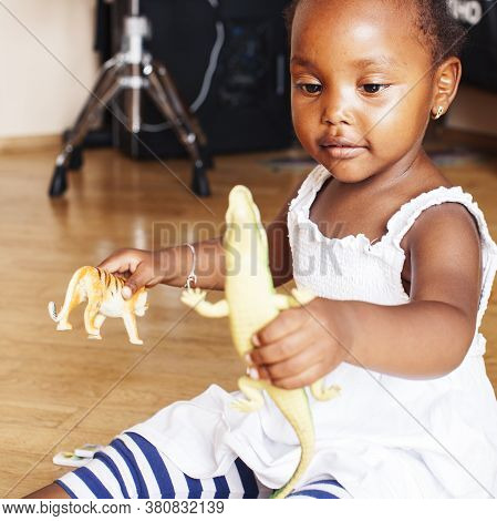 Little Cute African American Girl Playing With Animal Toys At Home, Pretty Adorable Princess In Inte